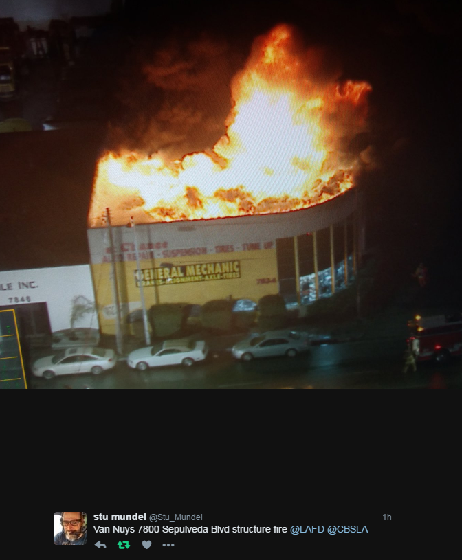 fire through the roof of building