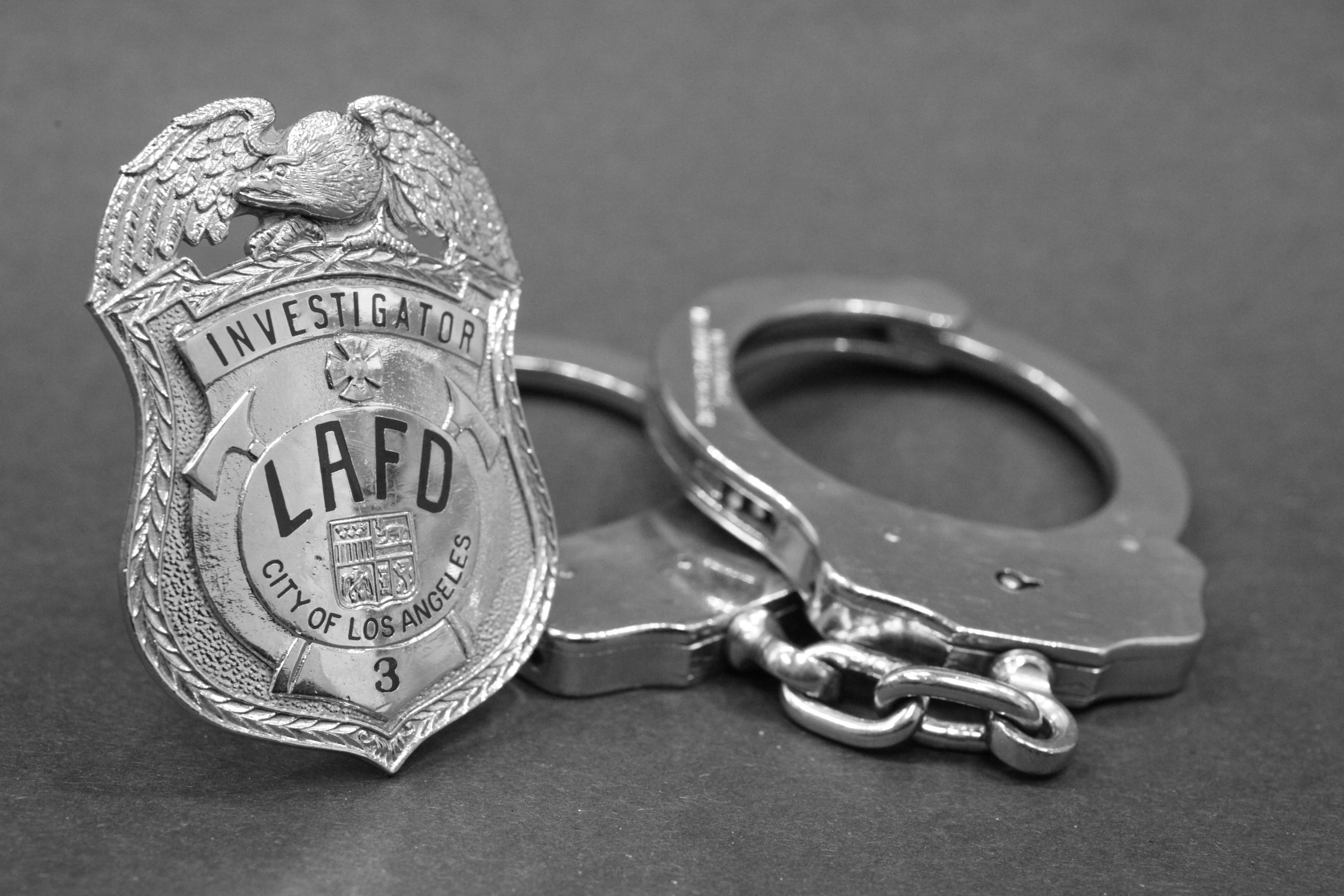 Arson Badge and handcuffs