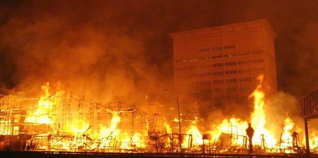 Huge wood framed structure ablaze.