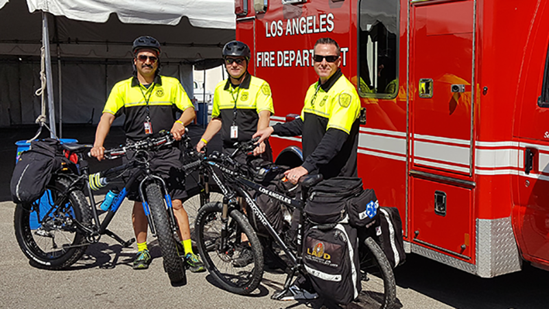 LAFD Firefighters standing in front of bicycles, as an advanced life support (ALS) Cycle Teams