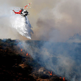 LAFD Helicopter dumping water on brush fire