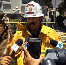 The LAFD Fire Chief talks to the media