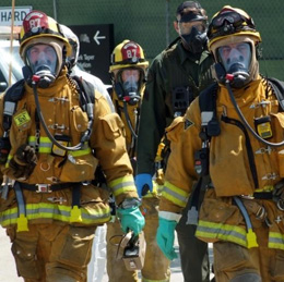 A group of firefighters in their hazmat gear