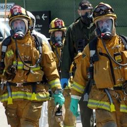 A hazmat team geared up for a new job