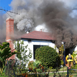 Smoke billowing out of a house
