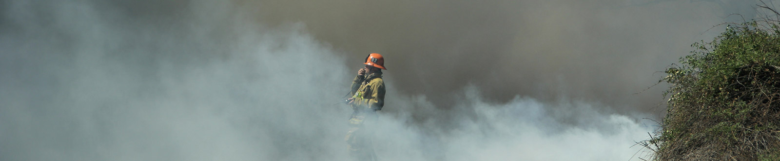 Firefighter standing in smoke