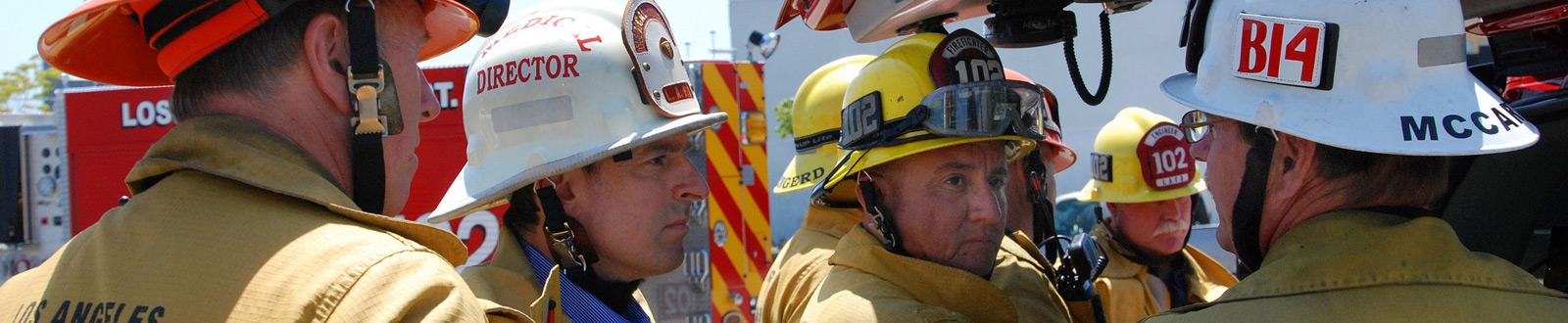 A group of firemen discuss next steps