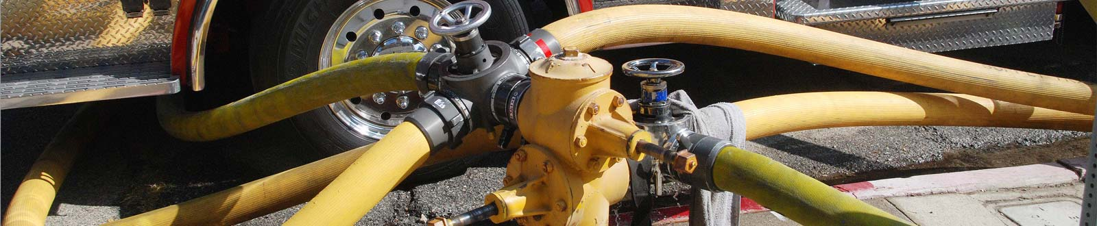 A fire hydrant with hoses attached
