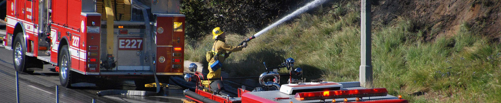 Firefighter extinguishes grass fire