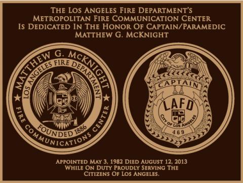 Honoring Mathew G McKnight black and gold plaque