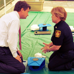 A woman teaches CPR