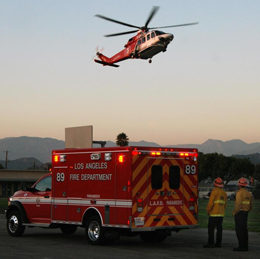 LAFD helicopter takes off from ambulance stage