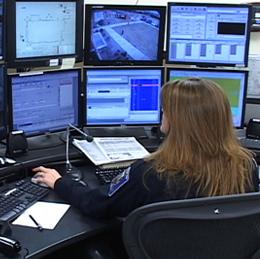 A woman 911 dispatcher at work