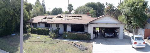 A man and woman were gravely injured at a fire in this West Hills home
