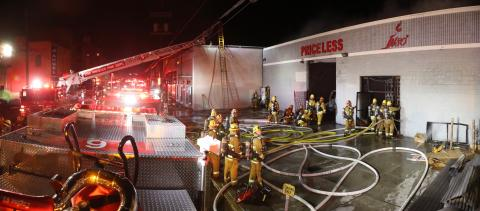 LAFD Firefighters at the scene of a just extinguished structure fire in the L.A. Fashion District