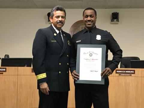 Los Angeles Fire Chief Ralph Terrazas (L) with Los Angeles Firefighter Kenneth Fraser holding Certificate of Appreciation