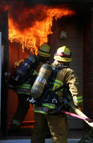 Firefighters make way into unit with heavy fire