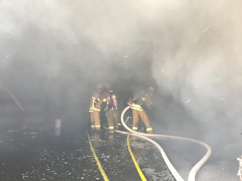 Los Angeles Firefighters inside burning paper recycling firm on October 5, 2017.
