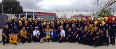 Noah surrounded by a group of LAFD Recruits