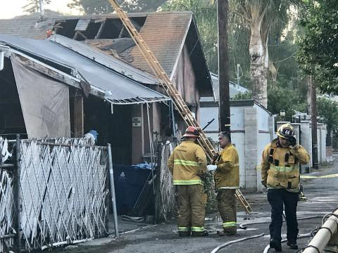 LAFD Firefighters Converse at Scene of Deadly Cypress Park Blaze