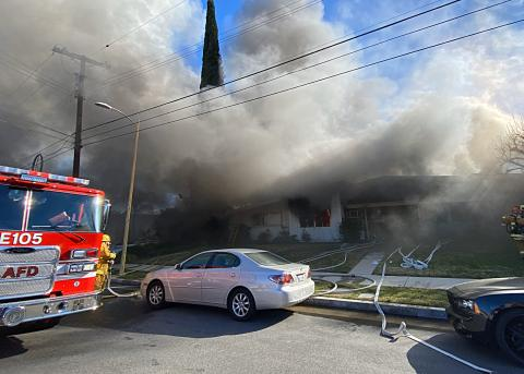 Los Angeles Firefighters at scene of Woodland Hills house fire.