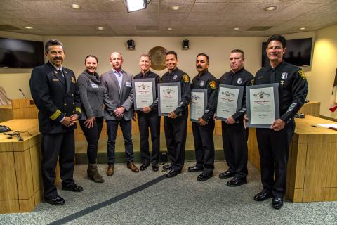 Los Angeles Fire Chief Ralph Terrazas (left) joins Mr. Will Beall and his wife in thanking LAFD responders who saved the Pacific Palisades mans life.