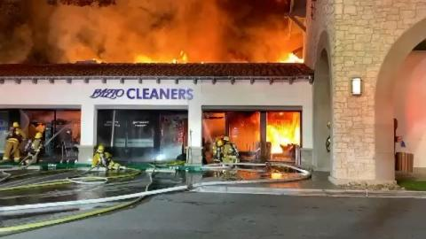 Front view of structure fire in a strip mall