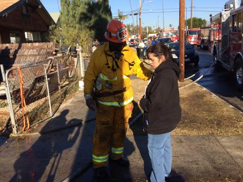 Fire Captain giving gift card to victim of house fire