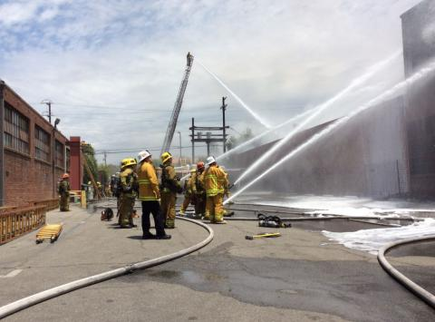 Large hand lines staffed by fire fighters during defensive operations