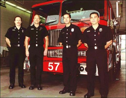Captain Dupee and his crew in front of fire engine 57.