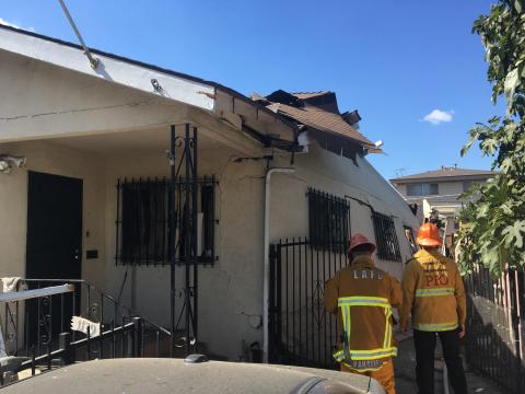 One-story home with significant structural damage from an explosion.