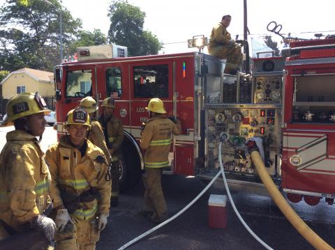 Firefighters in front of an Engine.