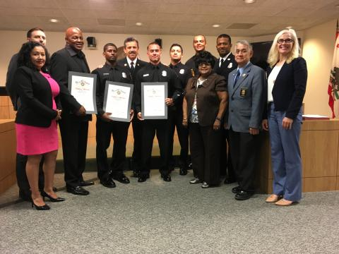 Honorees standing with Board of Fire Commission