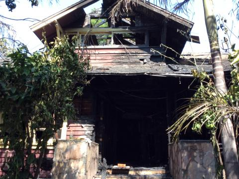 Exterior front of burnt home.