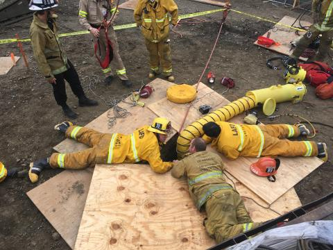 LAFD Firefighters Prepare to Rescue Man Trapped 50' Below Ground
