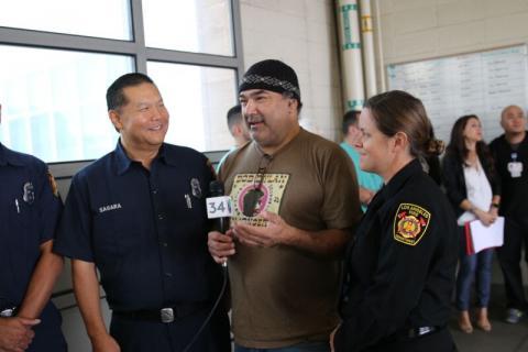 firefighters with cardiac survivor
