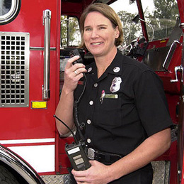 An LAFD-ACS volunteer uses the radio