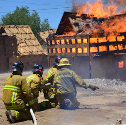 A team of cadets work together to stop a fire